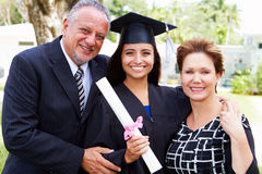 Hispanic Student And Parents Celebrate Graduation. Looking To Camera Smiling Royalty Free Stock Images