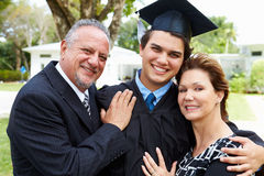 Hispanic Student And Parents Celebrate Graduation Stock Photo