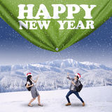 Hispanic students pulling new year banner Royalty Free Stock Photo