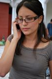 Hispanic students talking on their cellphones.  Royalty Free Stock Photography