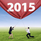 Hispanic teamwork drag number 2015 Stock Photos