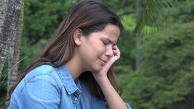 Hispanic Teen Girl Crying With Emotional Pain. Stock video in 4k or HD resolution stock video footage