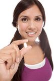 Hispanic teen girl with medicine pill Stock Image