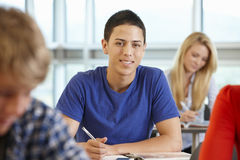 Hispanic teenage boy in class smiling to camera Royalty Free Stock Photo