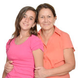 Hispanic teenage girl and her grandmother isolated on white Stock Photography