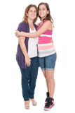 Hispanic teenage girl hugging her mother isolated on white Royalty Free Stock Photo