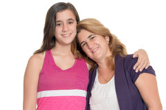 Hispanic teenage girl hugs her mother isolated on white Stock Images