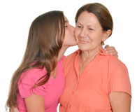 Hispanic teenage girl kissing her grandmother Royalty Free Stock Photography