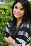 Hispanic teenage girl. Portrait of a Hispanic teenage girl smiling outside royalty free stock photo