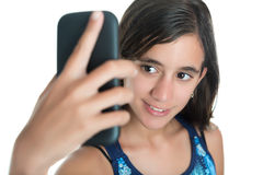 Hispanic teenage girl taking herself a photo with her mobile phone Royalty Free Stock Photography