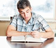 Hispanic teenager reading the Bible Stock Image