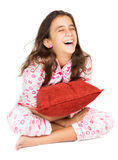 Hispanic teenager wearing pajamas and laughing Royalty Free Stock Photos