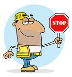 Hispanic traffic director man holding a stop sign Royalty Free Stock Photography