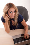 Hispanic twenties woman working on computer Royalty Free Stock Photos