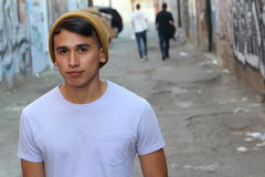 Hispanic urban young boy in alley way stock image