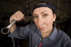 Hispanic woman in a agarage Stock Photo