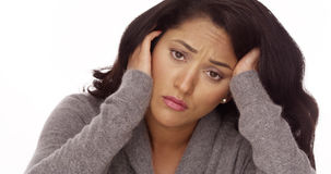 Hispanic woman with anxiety. Looking at camera stock photography