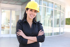Hispanic Woman Architect. A young pretty hispanic woman architect with at building work site Stock Photos