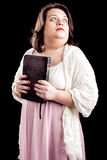 Hispanic woman with bible Stock Photos