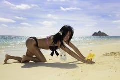 Hispanic woman in bikini at the beach Stock Image