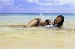 Hispanic woman in bikini at the beach Royalty Free Stock Photos