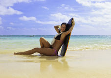 Hispanic woman in bikini at the beach Royalty Free Stock Photography