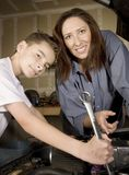 Hispanic woman and boy in garage Stock Photos