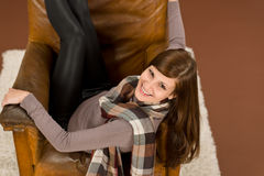 Hispanic woman on brown leather armchair Stock Photos