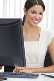 Hispanic Woman Businesswoman & Computer in Office Stock Images