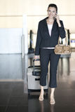 Hispanic woman calling at airport Royalty Free Stock Images