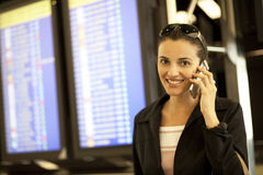 Hispanic woman calling at airport Royalty Free Stock Photos