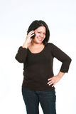 Hispanic woman with cell phone Stock Photography