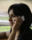 Hispanic Woman on Cell Phone Royalty Free Stock Images