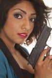 Hispanic woman close gun look Stock Images