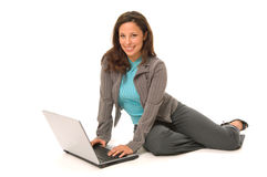 Hispanic woman with computer Stock Photos