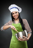 Hispanic woman cook with pot Royalty Free Stock Photography