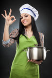 Hispanic woman cook with pot making ok sign Royalty Free Stock Photo
