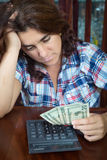 Hispanic woman counting money at home to pay the bills Royalty Free Stock Image
