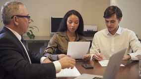 Hispanic woman discuss with lawyer and banker about important contract. Then have live and serious conversation at the meeting in office. Legal agreement stock footage
