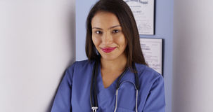 Hispanic woman doctor standing in office Stock Images