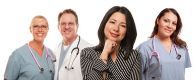 Hispanic Woman with Doctors and Nurses stock images