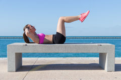 Hispanic woman doing ab crunches for fitness Royalty Free Stock Photography