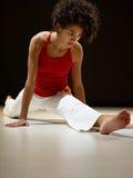 Hispanic woman doing leg splits Stock Photo