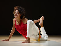 Hispanic woman doing stretching and yoga Stock Images