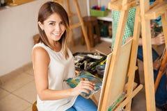 Hispanic woman enjoying art school Stock Image