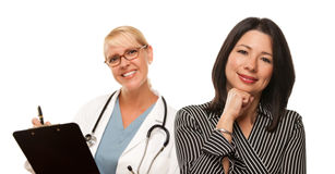 Hispanic Woman with Female Doctor or Nurse Royalty Free Stock Photography