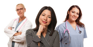 Hispanic Woman with Female Doctor and Nurse Stock Photography