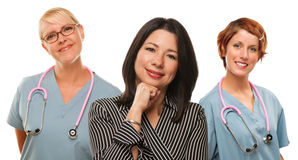 Hispanic Woman with Female Doctors and Nurses Royalty Free Stock Photo