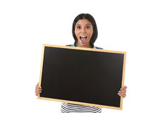 Hispanic woman or female student holding blank blackboard with copy space for adding message Royalty Free Stock Images