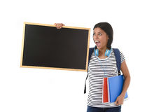 Hispanic woman or female student holding blank blackboard with copy space for adding message Royalty Free Stock Photography